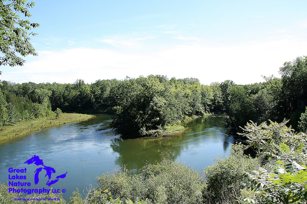 """This is one of the finest vantage points for the Big Manistee River that I know of, on a rugged stretch of trail that my friends and I have long referred to as the """"14 mile two-track"""". This particular river configuration will likely change, as bank erosion, a completely natural process, eventually breaches the peninsula that creates today's """"big bend"""". When that happens, the big bend will enter a new evolutionary chapter, perhaps becoming a richly diverse wetland. Whatever happens, the forces of nature are at work, constantly redefining the river's path."""