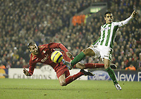 Photo: Aidan Ellis.<br /> Liverpool v Real Betis. UEFA Champions League.<br /> 23/11/2005.<br /> Liverpool's Peter Crouch misses another chance to score as Betis Gutierez Juanito lokks on