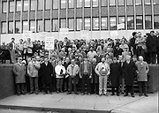 Thurles Sugar Workers Protest..1986..16.01.1986..01.16.1986..16th January 1986..After a rationionalisation plan was invoked the Irish Sugar Company which had already closed the sugar factory at Tuam now turned its attention to the factory at Thurles. The soon to be affected workers staged a protest against the cuts at the headquarters of The Sugar Company at Earlsfort Terrace,Dublin..The workers were supported by trade union officials and had much cross party support from Dail Eireann and The Seanad. Included among the protestors were,.Hugh Byrne TD,Sean Treacy TD, Senator Des Hanifin,Sean Byrne TD,Senator Mick Smith,.Maura Scully, Chairperson,Thurles,UDC, Cllr John O'Connor,David Moloney TD, Cllr Tom Condon, Pat Rabbitte, National General Secretary.IT&GWU,John Ryan TD,Leas Ceann Comhairle of the Dail,Senator Michael Ferris,Duputy Leader of the Senate,Labour spokesman on agriculture,Ned Brennan,Cllr Harry Byrne and Michael Kennedy TD...Image shows the Thurles and Tuam sugar workers as they assemble on the steps of the Sugar Company Headquarters at Earlsfort, Terrace