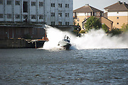 British made speedboat The XSR Interceptor 15m with guns and video camera shown in a anti pirate demonstration outside the ExCel centre in London, UK 0n September 12th 2011..The XRS Intercepter 15m is made by XSMG World.Photos Ki Price