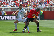 Real Madrid Midfielder Gareth Bale tackles Manchester United Defender Timothy Fosu-Mensah during the AON Tour 2017 match between Real Madrid and Manchester United at the Levi's Stadium, Santa Clara, USA on 23 July 2017.