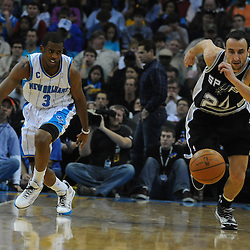 Jan 18, 2010; New Orleans, LA, USA; San Antonio Spurs guard Manu Ginobili (20) and New Orleans Hornets guard Chris Paul (3) chase down a loose ball during the first half at the New Orleans Arena. Mandatory Credit: Derick E. Hingle-US PRESSWIRE