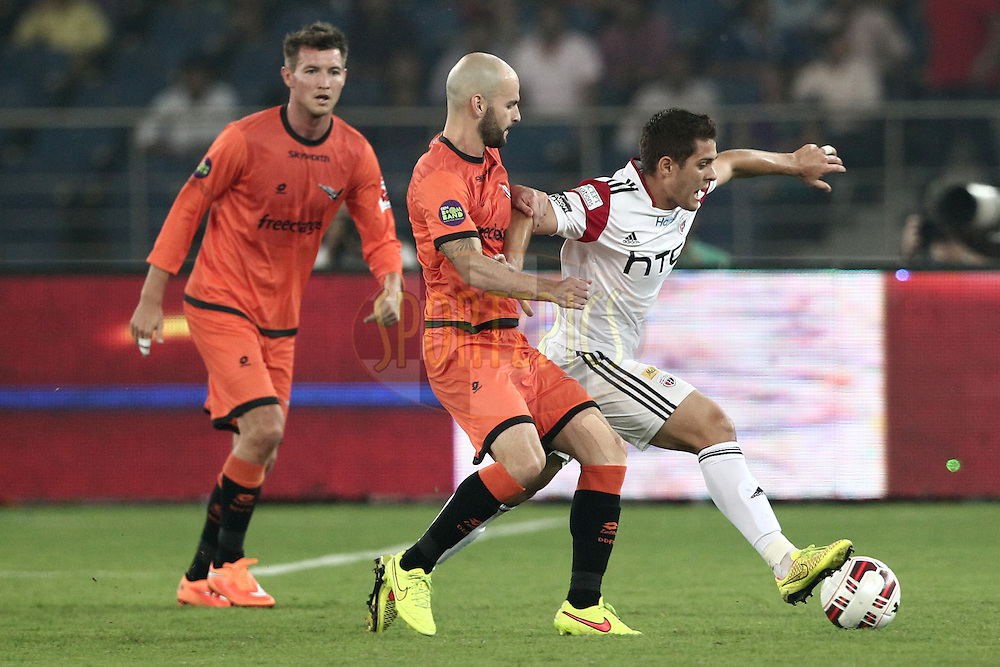 Hans Mulder of Delhi Dynamos FC trying to chase ball from Guilherme Felipe de Castro of NorthEast United FC during match 16 of the Hero Indian Super League between The Delhi Dynamos FC and NorthEast United FC held at the Jawaharlal Nehru Stadium, Delhi, India on the 29th October 2014.<br /> <br /> Photo by:  Deepak Malik/ ISL/ SPORTZPICS