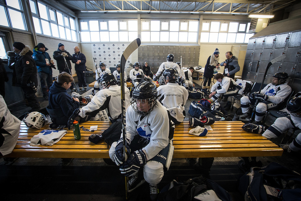 A junior hockey team prepares to practice outdoors before the Toronto Maple Leafs outdoor practice in Toronto, January 5, 2015.