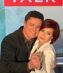"""Sharon Osbourne releases a photo on Instagram with the following caption: """"Sharing a moment with \u201cThe Peacock\u201d @DonnyOsmond on @TheTalkCBS today."""". Photo Credit: Instagram *** No USA Distribution *** For Editorial Use Only *** Not to be Published in Books or Photo Books ***  Please note: Fees charged by the agency are for the agency's services only, and do not, nor are they intended to, convey to the user any ownership of Copyright or License in the material. The agency does not claim any ownership including but not limited to Copyright or License in the attached material. By publishing this material you expressly agree to indemnify and to hold the agency and its directors, shareholders and employees harmless from any loss, claims, damages, demands, expenses (including legal fees), or any causes of action or allegation against the agency arising out of or connected in any way with publication of the material."""