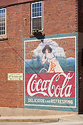 A old Coca-Cola advertising mural on the side of a building in the tiny village of Burnsville, North Carolina. Burnsville is the start of the Quilt Trail which honors handmade quilt designs of the rural Appalachian region.