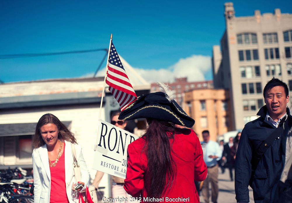HOBOKEN, NJ - June 05:  A supporter of Republican presidential candidate Ron Paul hands out leaflets on primary election day in front of the Hoboken PATH train entrance on June 05, 2012 in HOBOKEN, NJ.  (Photo by Michael Bocchieri/Bocchieri Archive)