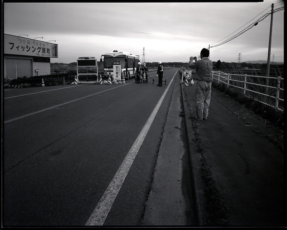 Minami Soma Police guard the  road leading tower Fukushima