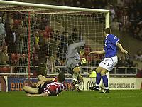 Photo. Glyn Thomas.<br /> Sunderland v Birmingham. FA Cup fifth round.<br /> Stadium of Light, Sunderland. 14/02/2004.<br /> Sunderland's Kevin Kyle (L) sends the ball past Maik Taylor (C) to equalise.