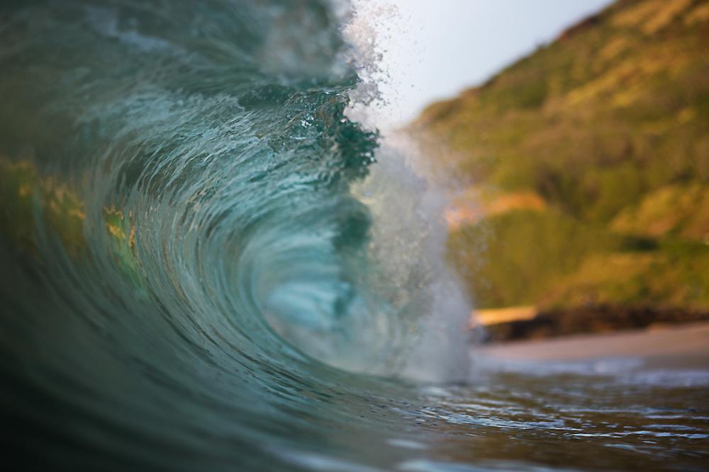 wave breaking at sandy beach.