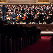 "December 12, 2012 - New York, NY : Conductor Gustavo Dudamel, on pedestal, leads the  Westminster Symphonic Choir and the Simón Bolívar Symphony Orchestra of Venezuela as they perform Antonio Estévez's ""Cantata criolla"" at Carnegie Hall's Stern Auditorium / Perelman Stage on Tuesday evening.  CREDIT: Karsten Moran for The New York Times"