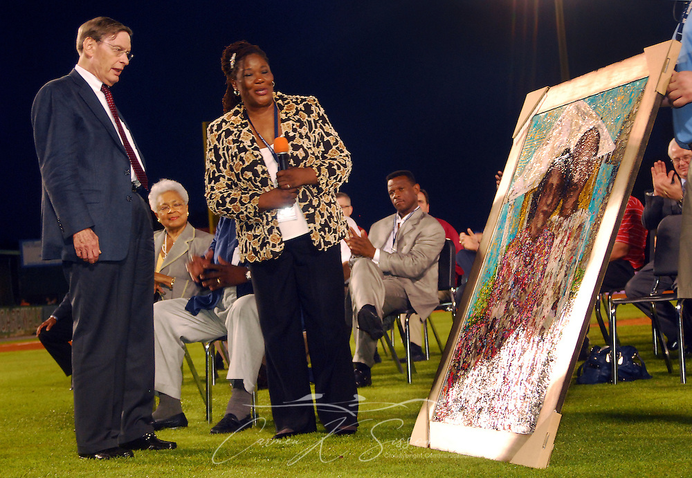 Major League Baseball Comissioner Bud Selig and Alfredia Aaron Scott, Hank Aaron's sister, examined a painting of Aaron and Scott's parents, presented by Scott to Aaron during the dedication of the Hank Aaron Childhood Home & Museum on Thursday, April 15, 2010 at Hank Aaron Stadium in Mobile, Ala. Aaron's childhood home was relocated from the Toulminville neighborhood to the stadium. (Apex MediaWire Photo by Carmen K. Sisson)