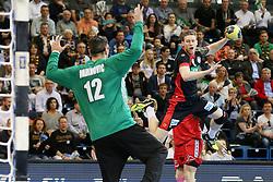 03.04.2016, Schwalbe Arena, Gummersbach, GER, Testspiel, Deutschland vs Oesterreich, im Bild Nikola Marinovic (#12, Oesterreich) und Tobias Reichmann (#9, Deutschland) beim Wurf // during the International Handball Friendly Match between Germany and Austria at the Schwalbe Arena in Gummersbach, Germany on 2016/04/03. EXPA Pictures © 2016, PhotoCredit: EXPA/ Eibner-Pressefoto/ Deutzmann<br /> <br /> *****ATTENTION - OUT of GER*****