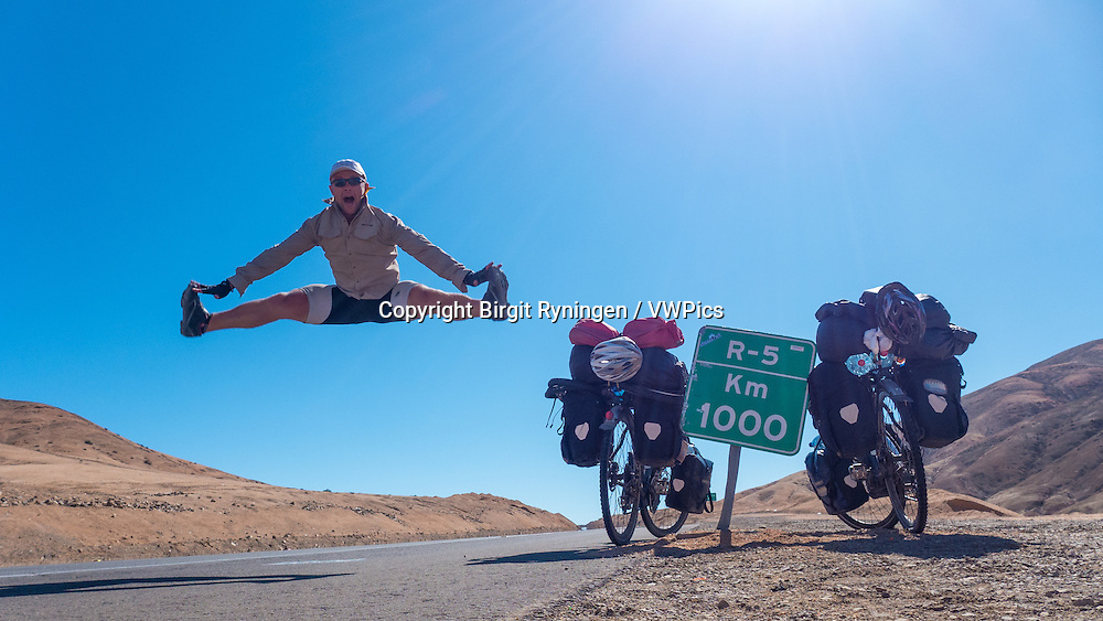 Cyclist jumping, Atacama, Chile