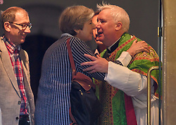 © Licensed to London News Pictures. 23/07/2017. Maidenhead, UK. British prime minister THERESA MAY kisses the vicar after attending church with her husband PHILIP MAY in her constituency in Maidenhead, Berkshire, UK . Photo credit: Ben Cawthra/LNP