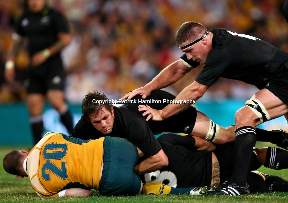 Richard Brown is tackled by Richie McCaw & Brad Thorn.All Blacks v Australia Tri Nations Rugby Union Test Match. Suncorp Stadium ,Brisbane. Australia,Saturday 13 September 2008 .