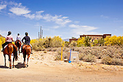 "22 MAY 2011 - SCOTTSDALE, AZ:  People on horseback pass a home (on the right) reportedly owned by Sarah Palin in Scottsdale, AZ. Most of the lots around the home are several acres big and many of the homeowners in the area have stables on their property. According to the Arizona Republic, Sarah Palin and her husband Todd Palin, bought the 8,000 square foot home for $1.695 million cash. The newspaper said the Palin's name does not appear on the paperwork and the home was bought by Safari Investments LLC out of Delaware. The paper said the deal ""appears designed to cloak the identity of a high-profile buyer."" The home has six bedrooms, five bathrooms, a six car garage, swimming pool, spa, home theater, wine cellar and children's ""jungle gym"" in the backyard. The home is surrounded by a tall wall with an electronic gate. Phoenix TV stations have reported that a black SUV with Alaska license plates has been seen entering and leaving the compound. People in the house have refused to comment on who owns the home. Neither Palin nor her husband have been seen at the home since news of the sale broke Saturday, May 21.   Photo by Jack Kurtz"