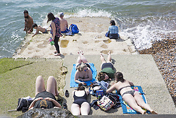 August 26, 2018 - Brighton, East Sussex, United Kingdom - Brighton, UK. Members of the public take to the beach in Brighton and Hove on the Bank holiday weekend Saturday. (Credit Image: © Hugo Michiels/London News Pictures via ZUMA Wire)