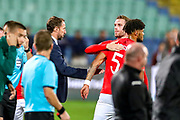 As ugly scenes develop England midfielder Jordan Henderson shows support for England defender Tyrone Mings during the UEFA European 2020 Qualifier match between Bulgaria and England at Stadion Vasil Levski, Sofia, Bulgaria on 14 October 2019.