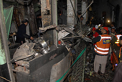 61017756<br /> Rescuers inspect the blast site in northwest Pakistan s Peshawar on Feb. 4, 2014.  At least eight people were killed and 25 others injured on Tuesday evening as a blast hit a busy market in Peshawar, local media reported, Tuesday, 4th February 2014. Picture by  imago / i-Images<br /> UK ONLY