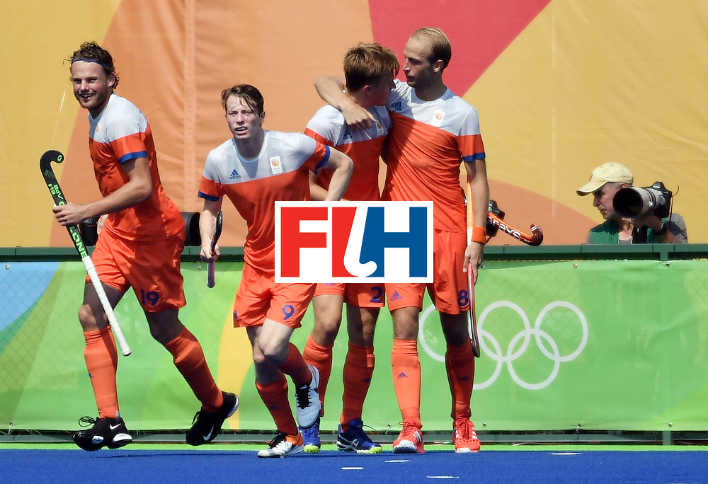 Netherlands' Jorrit Croon (2nd R) celebrates with teammates after scoring a goal during the men's Bronze medal field hockey Netherlands vs Germany match of the Rio 2016 Olympics Games at the Olympic Hockey Centre in Rio de Janeiro on August 18, 2016. / AFP / Pascal GUYOT        (Photo credit should read PASCAL GUYOT/AFP/Getty Images)