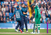 Picture by Allan McKenzie/SWpix.com - 19/05/2019 - Sport - Cricket - 5th Royal London One Day International - England v Pakistan - Emerald Headingley Cricket Ground, Leeds, England - England's Chris Woakes is congratulated on taking 6 wickets by dismissing Pakistan's Hassan Ali.