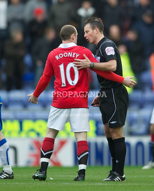 WIGAN, ENGLAND - Saturday, February 26, 2011: Referee Mark Clattenburg speaks to Manchester United's Wayne Rooney after he elbowed Wigan Athletic's James McCarthy, but as usual the referee failed to disicplin the Manchester United player, during the Premiership match at the DW Stadium. (Photo by David Rawcliffe/Propaganda)