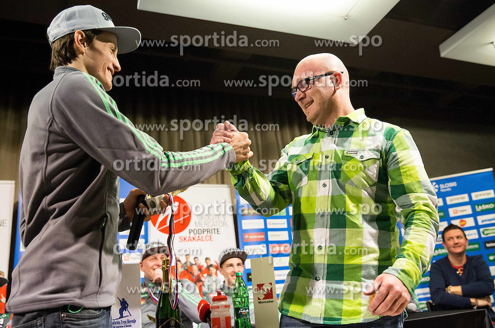 Peter Prevc and a replica of Four Hills Tournament trophy Eagle for Elan service team -  Aljosa Branc Justin during press conference of Slovenian Ski jumping team after World Cup competitions in Vikersund, on February 16, 2016 in Maximarket, Ljubljana, Slovenia. Photo by Vid Ponikvar / Sportida