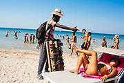 African peddler. Daily life at the San Francesco beach in Bari on 7 August 2019. Christian Mantuano / OneShot