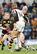 Twickenham, GREAT BRITAIN, Wasps' James HASKELL, tackled low by Scott NEWLAND, attempts to hand off Mark ROBERTSON, during the Heineken Cup Rugby Pool 2. Match, London Wasps vs Edinburgh , played at Adams Park, Wycombe, Buck, on Sun. 14.12.2008.  [Photo, Peter Spurrier/Intersport-images]