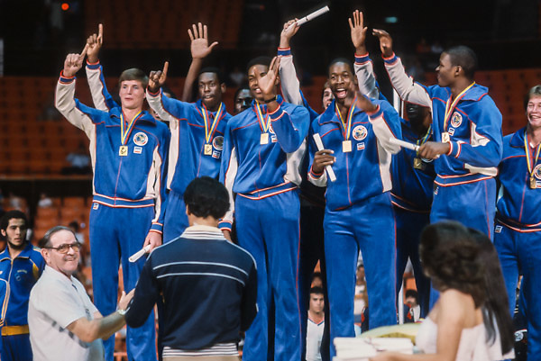 CARACAS, VENEZUELA -  AUGUST 1983:  The USA Men's Basketball Team receive their gold medals in the 1983 Pan Am Games basketball tournament held from August 15-27, 1983 in Caracas, Venezuela.  Visible players include Charlie Sitton (front row, far left), Sam Perkins (front row, third from left), and Wayman Tisdale (front row, fourth from left). (Photo by David Madison/Getty Images) *** Local Caption ***