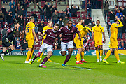 Steven MacLean (#18) of Heart of Midlothian FC runs to celebrate after scoring the equalising goal during the Ladbrokes Scottish Premiership match between Heart of Midlothian FC and Livingston FC at Tynecastle Park, Edinburgh, Scotland on 4 December 2019.