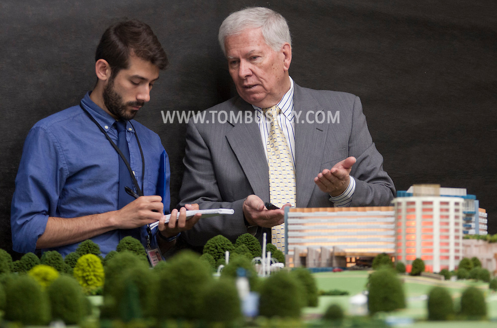Ellenville, New York - Project architect Peter Wilday, right,  of Wilday Architects talks to a reporter after a news conference where  Nevele Investors, LLC, unveiled a model of the $640 million Nevele Resort, Casino and Spa design in Ellenville on Thursday, June 12, 2014.