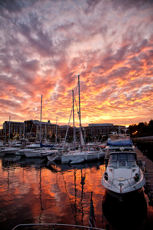 A brilliant sunset falls over Constitution Marina in Charlestown.  Marriot in Background