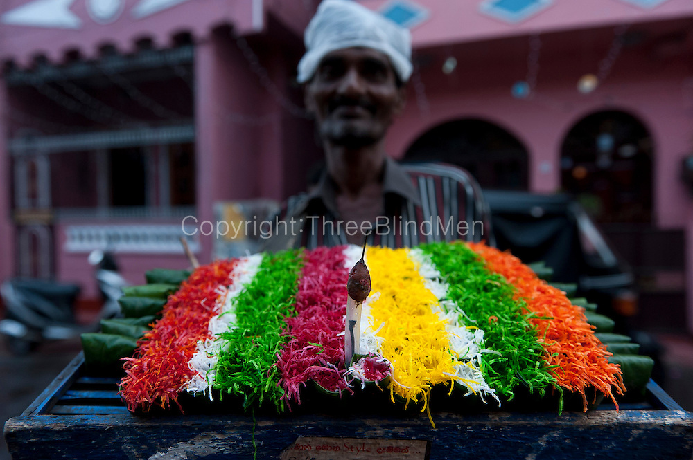 Street vendor selling Betel leaf with assorted (and coloured) fillings.