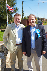 © Licensed to London News Pictures.  02/05/2013. AYLESBURY, UK. Clive Harriss (pictured right), Conservative party candidate for the Stone and Waddesdon on Buckinghamshire County council visits his local polling station during voting for the local council elections. Also in this picture: Barry Macleod-Cullinane (left). Photo credit: Cliff Hide/LNP