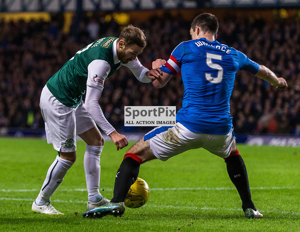 Martin Boyle is fouled by Lee Wallace during the match between Rangers and Hibernian (c) ROSS EAGLESHAM | Sportpix.co.uk