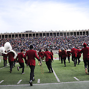 Harvard band members run onto the field for half time entertainment during the Harvard Vs Yale, College Football, Ivy League deciding game, Harvard Stadium, Boston, Massachusetts, USA. 22nd November 2014. Photo Tim Clayton