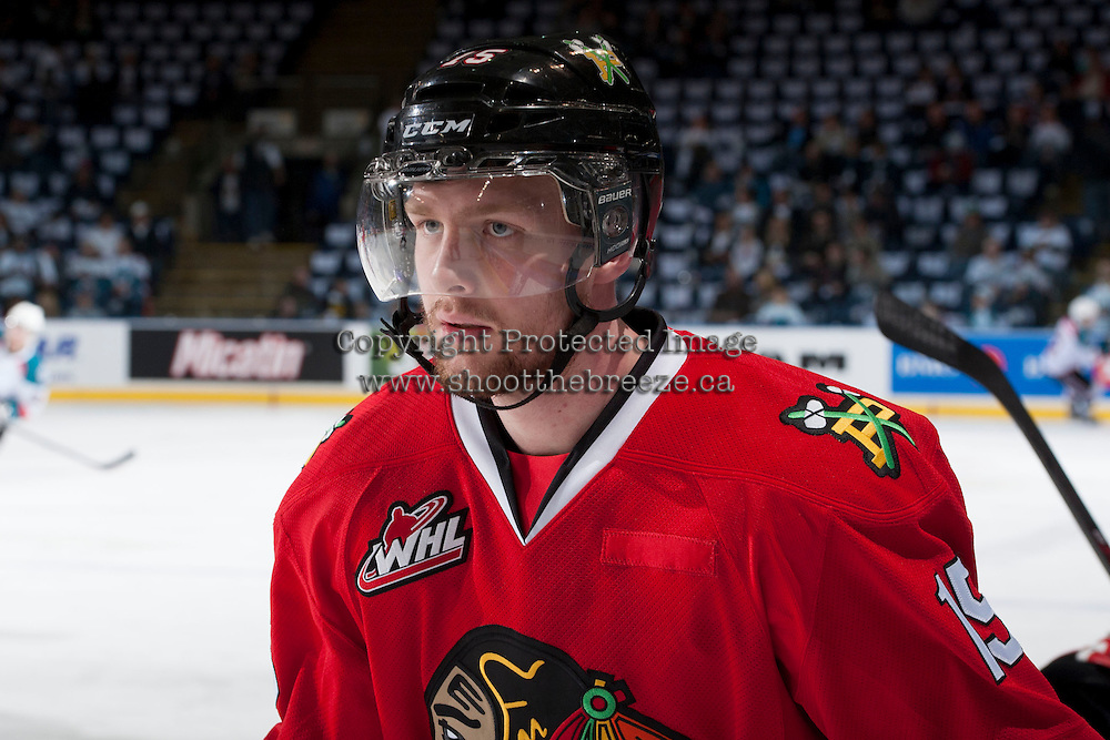 KELOWNA, CANADA - APRIL 18: Tyson Predinchuk #15 of the Portland Winterhawks stands at the bench during warm up against the Kelowna Rockets on April 18, 2014 during Game 1 of the third round of WHL Playoffs at Prospera Place in Kelowna, British Columbia, Canada.   (Photo by Marissa Baecker/Shoot the Breeze)  *** Local Caption *** Tyson Predinchuk;