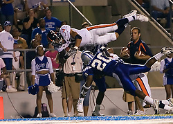 "Virginia wide receiver Andrew Pearman (21) dives for a touchdown. The Virginia Cavaliers football team defeated Middle Tennessee State Blue Raiders 23-21 at Johnny ""Red"" Floyd Stadium  in Murfreesboro, TN on October 6, 2007."