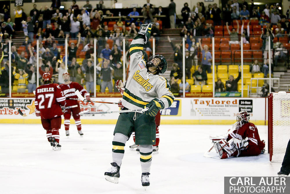 10/13/2006 - Anchorage, Alaska: Kevin Clark (9) of the Alaska-Anchorage Seawolves points to the sky in thanks for scoring a rebound goal in the Seawolves Nye Frontier Classic Championship game