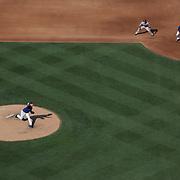 Pitcher Matt Harvey, New York Mets, pitching as A.J. Pollock, Arizona Diamondbacks, waits on first base during the New York Mets Vs Arizona Diamondbacks MLB regular season baseball game at Citi Field, Queens, New York. USA. 11th July 2015. Photo Tim Clayton