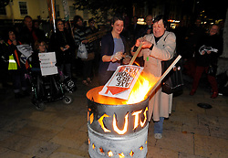 © Licensed to London News Pictures. 05/11/2013. Bristol, UK.  The People's Assembly anti-cuts campaigners stage a 'Bonfire of Austerity' in Bristol city centre on bonfire night.  Protesters burnt placards against cuts to the NHS, mental health services, bedroom tax, personal independence payments, and ATOS screening of incapacity and disabled benefit claimants.  05 November 2013.<br /> Photo credit : Simon Chapman/LNP