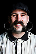 09.02.2017 - Coney Island Mustache/Beard Competition. By Erica Price.  Christian Fattorusso (Best styled mustache winner) Old baseball uniform
