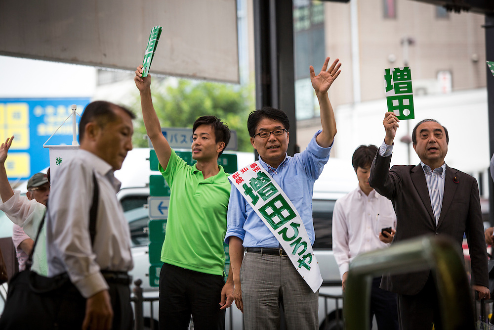 TOKYO, JAPAN - JULY 21 : Candidate Hiroya Masuda greets people during a Tokyo Gubernatorial Election 2016 campaign rally at Kanamachi Station, Tokyo, Japan on Thursday, July 21, 2016. Tokyo residents will vote on July 31 for a new Tokyo Governor who will deal with issues related to hosting the Summer Tokyo Olympics and Paralympics in 2020. (Photo: Richard Atrero de Guzman/NUR Photo)