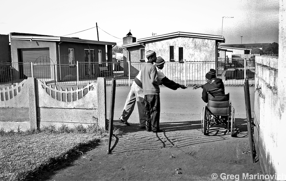 Thokoza, 2009. South Africa. Merchant Bonginkosi Mazibuko, former commander of Slovo section Self Defence Unit. Paralysed by a bullet in his spine, while robbing a shop after liberation in 1994. He was murdered in 2011, most likely because he was impeding another self defence unit member's claims to have been a commander during the conflict, and his potential political ascent. Photo Greg Marinovich