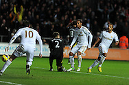 Swansea city's Jonathan de Guzman © scores his sides 2nd goal. Barclays Premier league, Swansea city v Norwich city at the Liberty Stadium in Swansea, South Wales on Saturday 8th Dec 2012. pic by Andrew Orchard, Andrew Orchard sports photography,