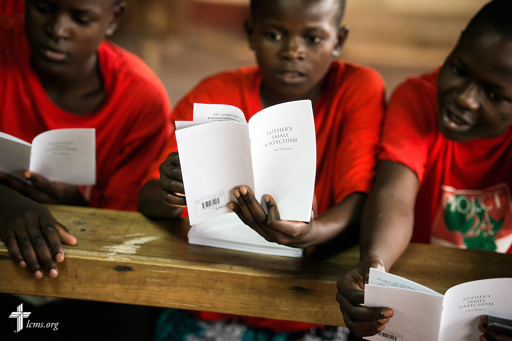 Young ladies read Luther's Small Catechism during catechism class at the Tumaini ELCK (Evangelical Lutheran Church in Kenya) Project 24 boarding facility on Sunday, Oct. 18, 2015, in Kisumu, Kenya. LCMS Communications/Erik M. Lunsford