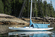 """Center Harbor, Maine - 9 August 2014. """"Butterfly"""" at anchor in the harbor."""
