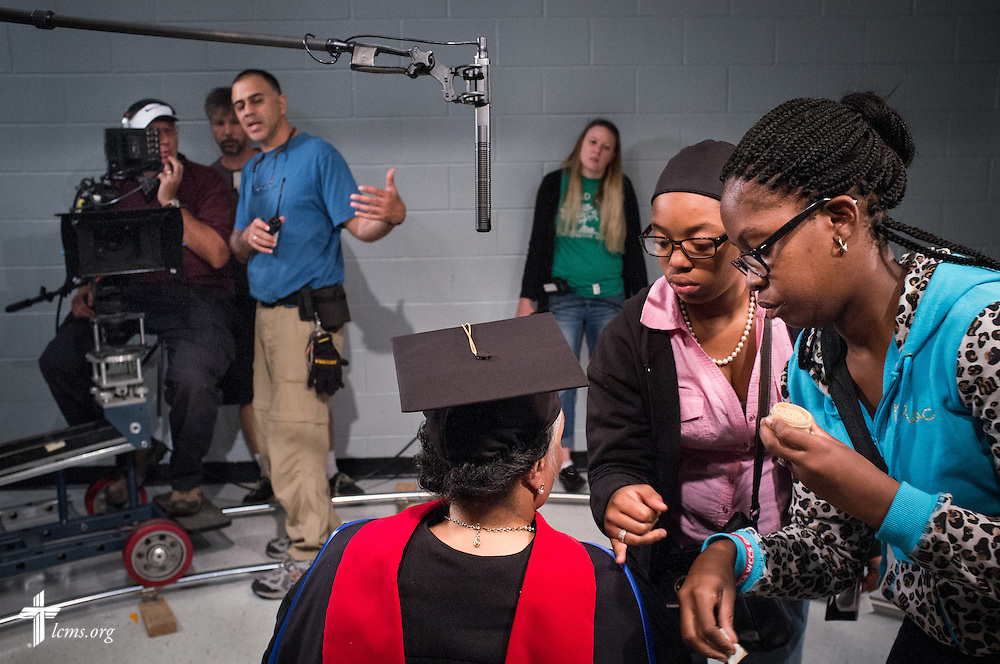 Actress Yvette Jones-Smedley (seated), performing the role of Rosa Young, receives assistance with makeup during the filming of 'The First Rosa' documentary on Thursday, September 25, 2014, at Concordia College Alabama in Selma, Ala. LCMS Communications/Erik M. Lunsford